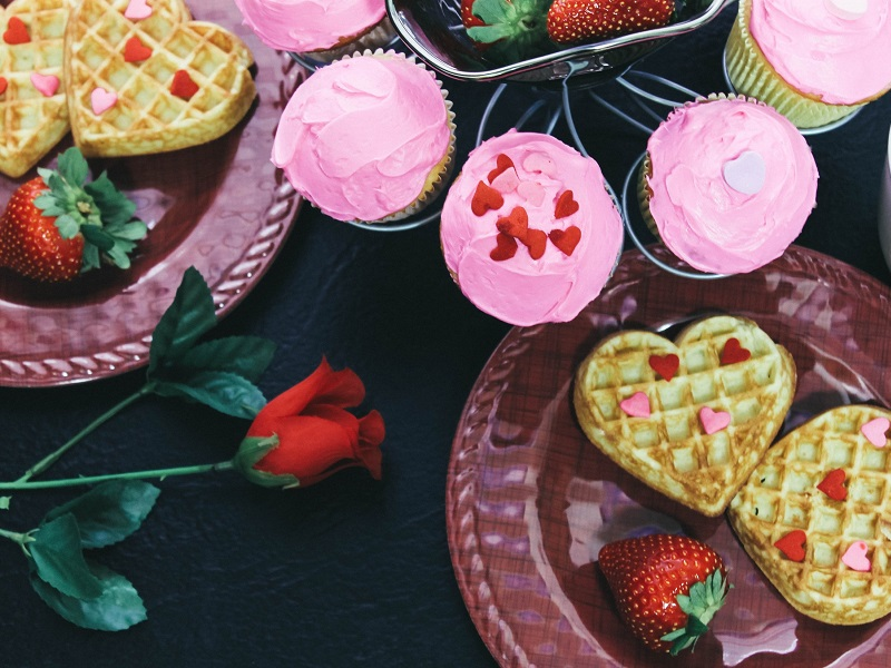 pink cupcakes and heart shaped waffles as an example of the love bombing phenomenon
